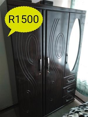 Dark wooden 3 door closet