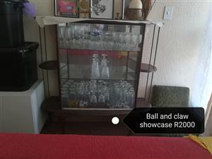 Ball and claw showcase for sale