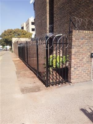 Carports, gates and palisading and razor wire.