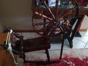 Antique spinning wheel.