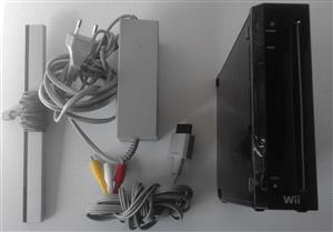 Wii Gaming Console, Adapter, Video Cable and Receiver. No Remotes and Nunjacks. In perfect working condition.
