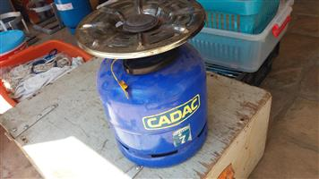 Cadac gas cylinder and cooker top
