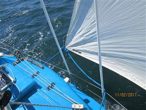C SHARP SAILING KEELBOAT WITH OUTBOARD ON TRAILER