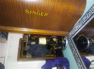 singer hand operated sewing machine with the hard cover