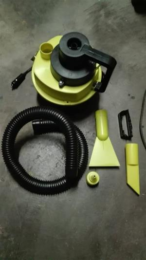 YELLOW AND BLACK VACUUM WITH FITTINGS