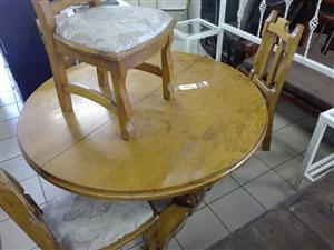 Wooden round table and chairs