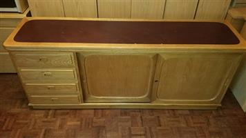 Oak sideboard with leather inlay