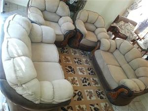4 Piece beige and black lounge suite
