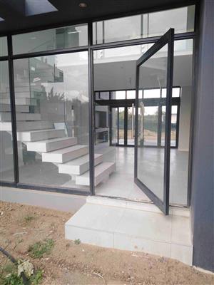 aluminium window frames, aluminium sliding doors, aluminium pivot doors, shop fronts