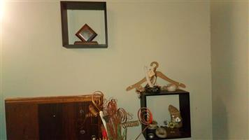 Wall shelves with decorative ornaments