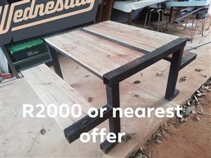 Saligna wood And steel picnic table for sale.
