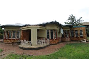 Large 1,903 square meter stand with 2 houses located on a main and busy road very close to North West University (NWU)