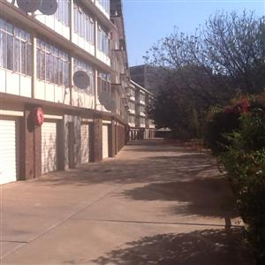 Queenswood. Spacious 2.5 bedroom flat for rent in secure building.  R6600 monthly. Lock-up garage. Close to university, schools, shopping mall and all amenities.