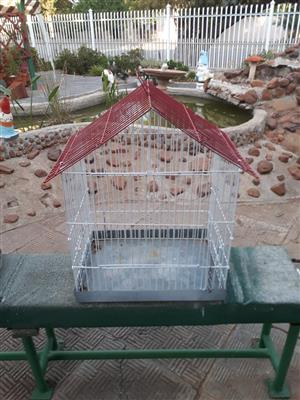 Red and white small bird cage