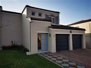 Beautiful 2 Bedroom house with home office for sale. In a Security Estate